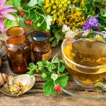 43283067 - cup of herbal tea with wild flowers and various herbs